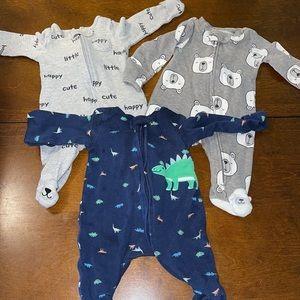 Lots of newborn pajamas